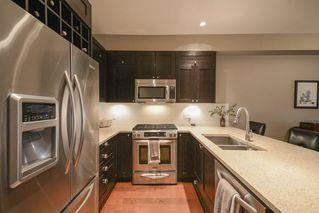 Photo 4: 202 15175 36 Avenue in Surrey: Morgan Creek Condo for sale (South Surrey White Rock)  : MLS®# R2356116