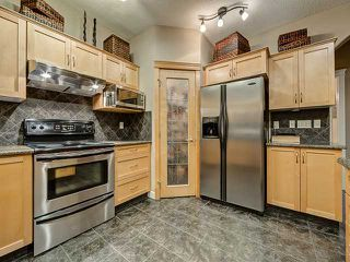 Photo 7: 150 CRESTRIDGE Way SW in CALGARY: Crestmont Residential Detached Single Family for sale (Calgary)  : MLS®# C3595084