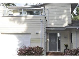 "Photo 1: 306 1585 FIELD Road in Sechelt: Sechelt District Townhouse for sale in ""PORT STALASHAN"" (Sunshine Coast)  : MLS®# V1089650"