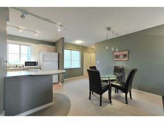 "Photo 1: 306 12083 92A Avenue in Surrey: Queen Mary Park Surrey Condo for sale in ""Tamaron"" : MLS®# F1430148"