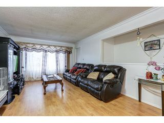 Photo 3: 7541 17TH AVENUE - LISTED BY SUTTON CENTRE REALTY in Burnaby: Edmonds BE House 1/2 Duplex for sale (Burnaby East)  : MLS®# R2030562