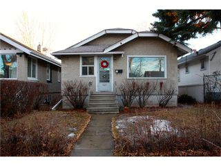 Main Photo: 311 7 Avenue NE in Calgary: Crescent Heights House for sale : MLS®# C4046690