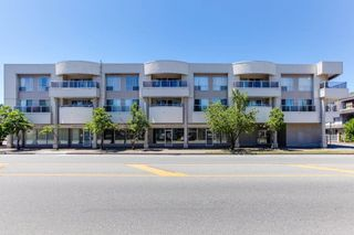 "Photo 1: 313 13771 72A Avenue in Surrey: East Newton Condo for sale in ""NEWTOWN PLAZA"" : MLS®# R2287531"