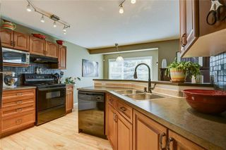 Photo 10: 387 MILLRISE Square SW in Calgary: Millrise Detached for sale : MLS®# C4203578