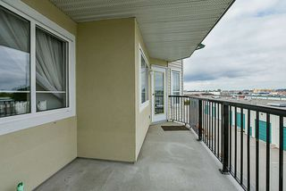 """Photo 19: 412 5759 GLOVER Road in Langley: Langley City Condo for sale in """"College Court"""" : MLS®# R2301267"""