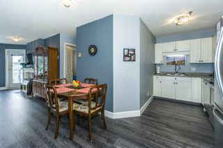 """Photo 2: 410 33688 KING Road in Abbotsford: Poplar Condo for sale in """"College Park Place"""" : MLS®# R2340929"""