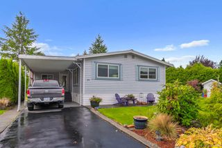 "Photo 1: 20 2303 CRANLEY Drive in Surrey: King George Corridor Manufactured Home for sale in ""Sunnyside Estates"" (South Surrey White Rock)  : MLS®# R2413496"