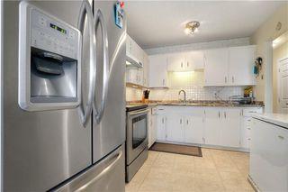 Photo 4: 70 FALCONRIDGE Close NE in Calgary: Falconridge Semi Detached for sale : MLS®# C4296980