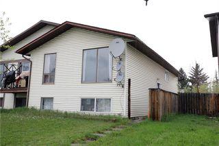 Photo 1: 70 FALCONRIDGE Close NE in Calgary: Falconridge Semi Detached for sale : MLS®# C4296980