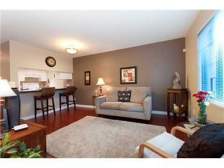 """Photo 1: 107 929 W 16TH Avenue in Vancouver: Fairview VW Condo for sale in """"Oakview Gardens"""" (Vancouver West)  : MLS®# V921322"""