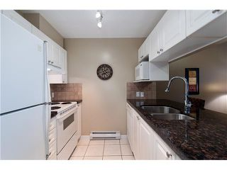 """Photo 4: 107 929 W 16TH Avenue in Vancouver: Fairview VW Condo for sale in """"Oakview Gardens"""" (Vancouver West)  : MLS®# V921322"""
