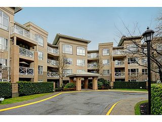 "Photo 1: 110 2551 PARKVIEW Lane in Port Coquitlam: Central Pt Coquitlam Condo for sale in ""THE CRESCENT"" : MLS®# V1041287"