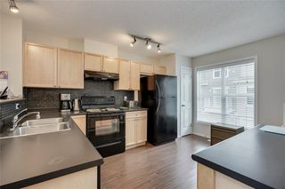 Photo 3: 55 Toscana Garden NW in Calgary: Tuscany Row/Townhouse for sale : MLS®# C4243908