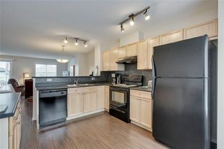 Photo 5: 55 Toscana Garden NW in Calgary: Tuscany Row/Townhouse for sale : MLS®# C4243908