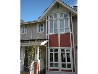 """Main Photo: 3208 E 54TH Avenue in Vancouver: Champlain Heights Townhouse for sale in """"CHAMPLAIN VILLAGE"""" (Vancouver East)  : MLS®# V893730"""