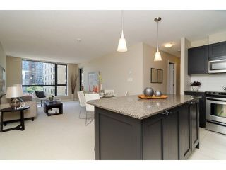 """Photo 9: 504 7225 ACORN Avenue in Burnaby: Highgate Condo for sale in """"AXIS"""" (Burnaby South)  : MLS®# V1071160"""