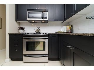 """Photo 11: 504 7225 ACORN Avenue in Burnaby: Highgate Condo for sale in """"AXIS"""" (Burnaby South)  : MLS®# V1071160"""