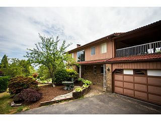 Photo 1: 338 OXFORD Drive in Port Moody: College Park PM House for sale : MLS®# V1129682