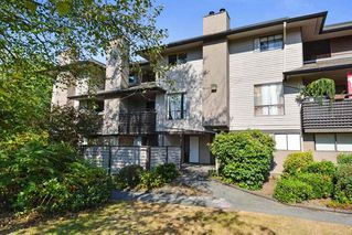 Photo 1: 10590 HOLLY PARK Lane in Surrey: Guildford Townhouse for sale (North Surrey)  : MLS®# R2296669
