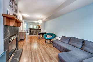 """Photo 3: 101 2000 PANORAMA Drive in Port Moody: Heritage Woods PM Townhouse for sale in """"MOUNTAINS EDGE"""" : MLS®# R2309703"""