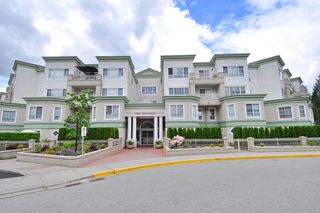 "Photo 1: 406 2960 PRINCESS Crescent in Coquitlam: Canyon Springs Condo for sale in ""THE JEFFERSON"" : MLS®# R2383661"