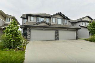 Photo 1: 1649 HAMMOND Crescent in Edmonton: Zone 58 House Half Duplex for sale : MLS®# E4169441