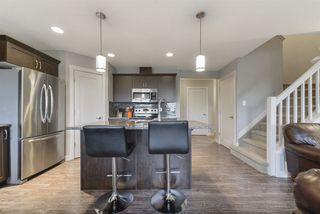 Photo 2: 1649 HAMMOND Crescent in Edmonton: Zone 58 House Half Duplex for sale : MLS®# E4169441