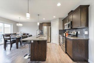Photo 4: 1649 HAMMOND Crescent in Edmonton: Zone 58 House Half Duplex for sale : MLS®# E4169441