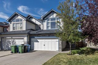 Photo 1: 71 SILVERADO RANGE Heights SW in Calgary: Silverado Semi Detached for sale : MLS®# A1030732