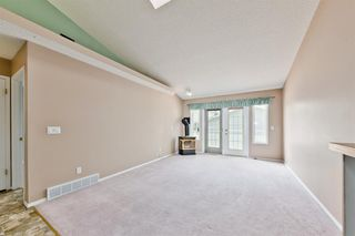 Photo 11: 29 12 Woodside Rise NW: Airdrie Row/Townhouse for sale : MLS®# A1038242