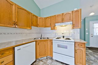 Photo 6: 29 12 Woodside Rise NW: Airdrie Row/Townhouse for sale : MLS®# A1038242
