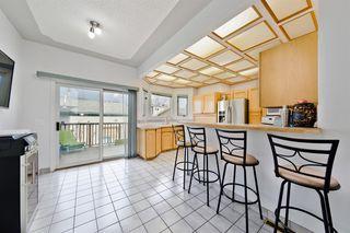 Photo 9: 228 28 Avenue NE in Calgary: Tuxedo Park Detached for sale : MLS®# A1046850