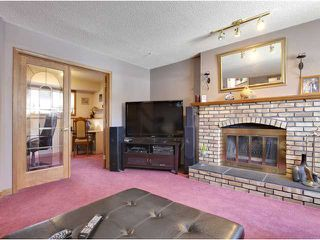 Photo 16: 57 Woodmark Crescent SW in CALGARY: Woodbine Residential Detached Single Family for sale (Calgary)  : MLS®# C3602089