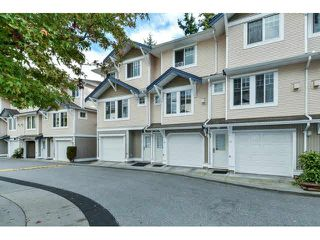 "Photo 1: 60 6533 121ST Street in Surrey: West Newton Townhouse for sale in ""STONEBRAIR"" : MLS®# F1422677"