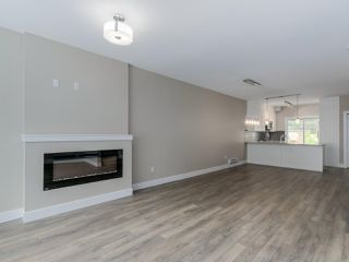 """Photo 2: 303 1405 DAYTON Street in Coquitlam: Burke Mountain Townhouse for sale in """"ERICA"""" : MLS®# R2119298"""