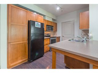 "Photo 6: 103 33318 E BOURQUIN Crescent in Abbotsford: Central Abbotsford Condo for sale in ""NATURES GATE"" : MLS®# R2363358"
