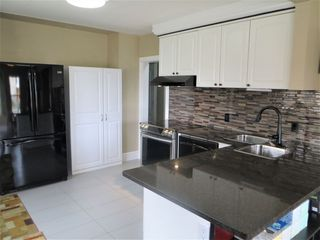 Photo 5: 6303 118 Avenue in Edmonton: Zone 09 House for sale : MLS®# E4156216