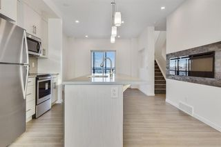 Photo 7: 333 Sage Hill Circle NW in Calgary: Sage Hill Row/Townhouse for sale : MLS®# A1026544