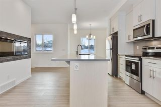 Photo 5: 333 Sage Hill Circle NW in Calgary: Sage Hill Row/Townhouse for sale : MLS®# A1026544