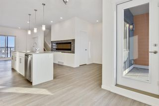 Photo 11: 333 Sage Hill Circle NW in Calgary: Sage Hill Row/Townhouse for sale : MLS®# A1026544