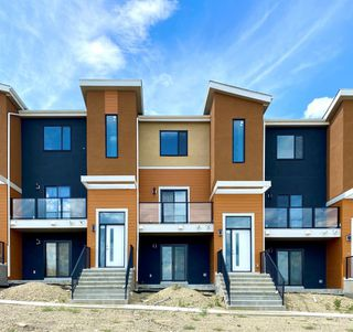 Photo 2: 333 Sage Hill Circle NW in Calgary: Sage Hill Row/Townhouse for sale : MLS®# A1026544