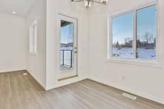 Photo 10: 333 Sage Hill Circle NW in Calgary: Sage Hill Row/Townhouse for sale : MLS®# A1026544