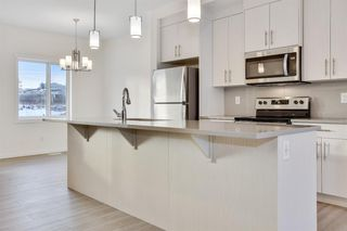 Photo 3: 333 Sage Hill Circle NW in Calgary: Sage Hill Row/Townhouse for sale : MLS®# A1026544