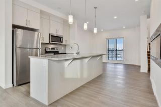 Photo 8: 333 Sage Hill Circle NW in Calgary: Sage Hill Row/Townhouse for sale : MLS®# A1026544
