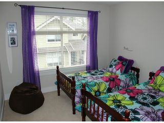 """Photo 9: 50 22225 50TH Avenue in Langley: Murrayville Townhouse for sale in """"Murray's Landing"""" : MLS®# F1409670"""