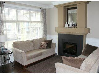"""Photo 2: 50 22225 50TH Avenue in Langley: Murrayville Townhouse for sale in """"Murray's Landing"""" : MLS®# F1409670"""