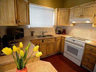 Photo 4: 124 MILLSIDE Road SW in CALGARY: Millrise Residential Detached Single Family for sale (Calgary)  : MLS®# C3612482