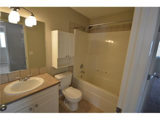 Photo 10: 1007 CREEK SPRINGS Rise NW: Airdrie House for sale : MLS®# C4022944