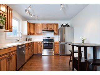 Photo 12: 31 STRATHEARN Crescent SW in Calgary: Strathcona Park House for sale : MLS®# C4076138