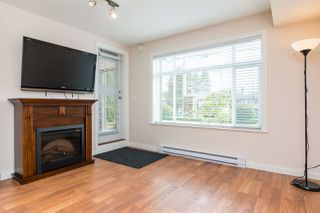 Photo 3: 114 19939 55A Avenue in Langley: Langley City Condo for sale : MLS®# R2248013